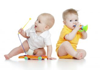 funny boy baby  with musical toys.